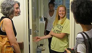 Professor Jessica Richard (left) greets a student.