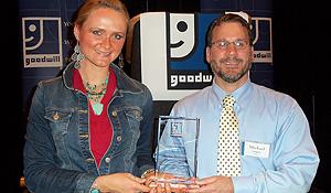 Megan Anderson and Michael Logan accepting award