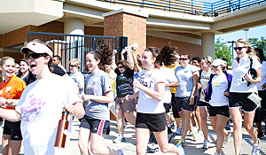 Women run onto the field for the football clinic