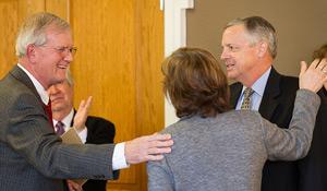 Dean Jacque Fetrow (center) congratulates Dean Toby Hale (left) and Dean Paul Orser.
