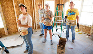 Staff members work on the 2010 house.