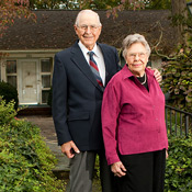 Henry and Elizabeth Stroupe pose in front of their Faculty Drive home in 2006.