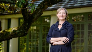 Allison Perkins, the director of the Reynolda House Museum of American Art at Wake Forest University, poses outside the house on Tuesday, June 23, 2015.